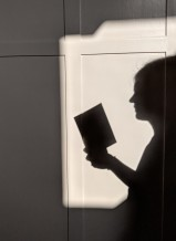 shadow woman reading a book
